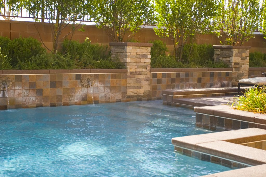 warm swimming pool with tiled outside after a pool heater repair Glendale, AZ